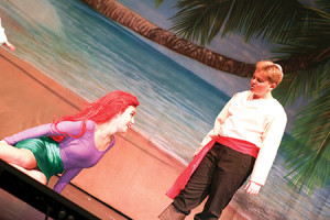 """Josh A. of Beth Tfiloh's class of 2020 and Sophie J. perform in """"The Little Mermaid Jr.,"""" which Beth Tfiloh's performing arts camp put on this week to a capacity crowd. The entire production was produced by students and counselors, including sets, costume, lighting and sound, in three weeks. (provided("""