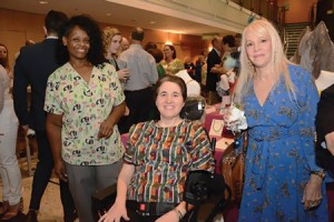 Beth Tenser (center), pictured with her caretaker and  designer Ann Kagan (right), pose at a BRAnanza fundraiser at Mercy Medical Center in July. Tenser founded the fundraiser, which features  a gallery of distinctively designed bras by local artists and businesses that are auctioned off to benefit The Fund for Excellence in Women's Health & Medicine. (provided)