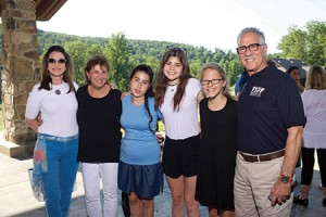 FIDF Washington Chapter Chairman Robert Burman (right) and his family visit with a group of LEGACY teens. The FIDF LEGACY program had 15 children and siblings of fallen IDF soldiers  visit the U.S. last month as part of a two-week recreation camp with  American kids. (Provided)