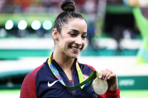 Silver medalist Alexandra Raisman of the United States poses for photographs after the medal ceremony for the Women's Individual All Around on Day 6 of the 2016 Rio Olympics at Rio Olympic Arena on August 11, 2016 in Rio de Janeiro, Brazil.  (Photo by Elsa/Getty Images)