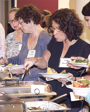 Jewish Veg supporters enjoying vegan food at the organization's 40th anniversary celebration