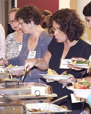 Jewish Veg supporters enjoying vegan food at the organization's 40th anniversary celebration