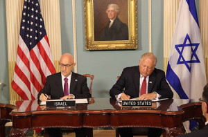 Jacob Nagel, Israel's acting national security adviser, signs a Memorandum of Understanding for $38 billion of U.S. defense    assistance over 10 years with Undersecretary of State Tom Shannon. (Embassy of Israel)