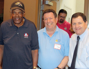 NFL Hall of Famer and Baltimore Colt great Lenny Moore joined the Chizuk Amuno Congregation Brotherhood at a barbecue on Aug. 31. Also pictured is Brotherhood president Eric Beser (center) and Rabbi Ron Shulman.