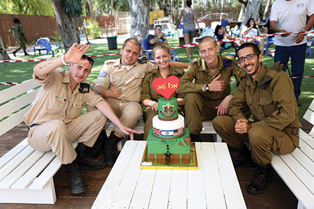 """FIDF FUN DAY: IDF lone soliders celebrate their birthdays on Sept. 15 at the FIDF's largest-ever """"fun day"""" at Israel's largest waterpark, located just outside of Jerusalem. There are about 6,400 lone soldiers from 80 countries serving in the IDF, about 880 of whom are American."""