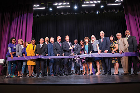Baltimore County Executive Kevin Kamenetz gets ready to cut the ribbon. To his left are BCPS superintendent Dallas Dance and Pikesville High principal Sandra Reid. (Photos provided via flickr.com/photos/baltimorecounty/iNG VISUALS)