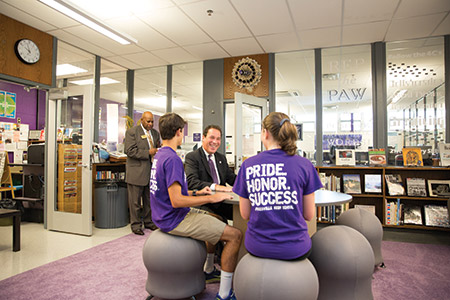 Two Pikesville students share their enthusiasm with Kevin Kamenetz.