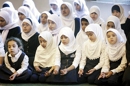 Above: Students at a Muslim  elementary school in Morton Grove, Ill., pray in the school gymnasium. (Students: Scott Olson/Getty Images)