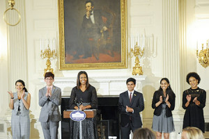 Michelle Obama joins national student poets (from left) Maya Salameh, Joey Reisberg, Gopal Raman, Maya Eashwaran and Stella Binion in the State Dining Room of the White House. (Kevin Wolf/AP Images for Alliance for Young Artists & Writers, PRNewsFoto)