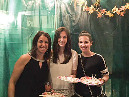 The Jewish Federation of Howard County's young adult division, oxyGEN, hosted sushi in the sukkah on Oct. 20 at the sukkah of two federation members. (Provided)