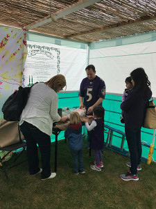 Community members help decorate a sukkah in the front circle of the Owings Mills JCC on Oct. 16. The JCC invited the community into the sukkah for a number of events over the course of the holiday.