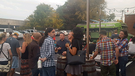 Charm City Tribe's mobile sukkah draws a crowd at Union Craft Brewing.