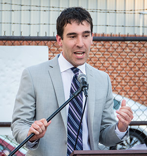 Zeke Cohen addresses Baltimore residents at a community event held by his nonprofit, The Intersection. (Photo provided)