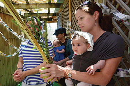 For many, the joy of Sukkot is all about family. (Courtesy of jta.org)
