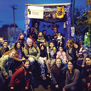Rabbi Jessy Gross (seated, wearing a winter hat) and Charm City Tribe take their mobile sukkah on the road. (Provided)