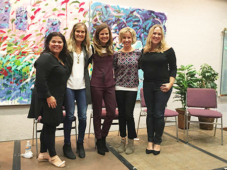 """MOM'S NIGHT OUT: From left: Ellen Allen, owner of a lifestyle products brand; Kirstein Quigley, co-founder of environmentally friendly product company 3greenmoms; Nicole Feliciano, author of """"MomBoss: Balancing Entrepreneurship, Kids, and Success""""; Amy Mascott, author and creator of educational website teachmama.com; and blogger Jessica McFadden speak at Mom's Night Out at the Gordon Center on Sept. 29. The event, co-presented with The Ivy Bookshop, was attended by about  60 women. Photo provided"""