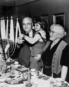 A family lights the menorah in this Associated publicity photo, circa 1980. (Snapshot: Courtesy of the Jewish Museum of Maryland, 1996.63.53)