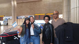 George and Amy Camara, with two of their four children, arrive in  Israel, Nov. 2, 2016 (Courtesy of the International Fellowship of Christians and Jews)