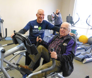 Edward A. Myerberg Center fitness trainer Ross Wilson introduces prospective new member Barry Feldman to the recumbent stepper during the center's recent open house during which community members had the chance to sample the Myerberg's programs from  fitness to art. (Photo Provided)
