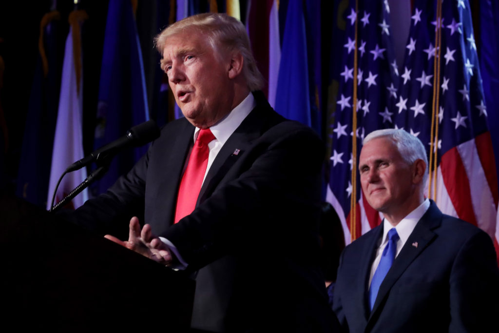 President-elect Donald Trump delivering his acceptance speech as Vice President-elect Mike Pence looks on at the New York Hilton Midtown in Manhattan, Nov. 9, 2016. (Chip Somodevilla/Getty Images) NEW YORK, NY - NOVEMBER 09: Republican president-elect Donald Trump delivers his acceptance speech as Vice president-elect Mike Pence looks on during his election night event at the New York Hilton Midtown in the early morning hours of November 9, 2016 in New York City. Donald Trump defeated Democratic presidential nominee Hillary Clinton to become the 45th president of the United States. (Photo by Chip Somodevilla/Getty Images)