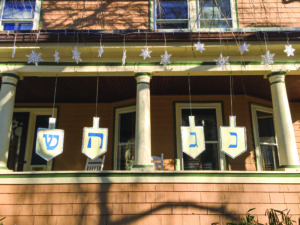 Snowflakes and eight supersized spinning dreidels displaying Hebrew letters adorn the McGinitys' home. (Photo by Keren McGinity)