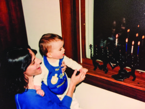 Keren McGinity teaches her daughter, Shira, about Chanukah. (Provided)