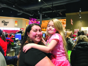 Saadya Baron and her daughter enjoy the JCC Chanukah event at the Foundry Row Wegmans. (Photo by JCC)