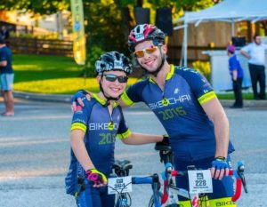 Moshe Moskowitz, left, with his brother during Bike4Chai.