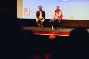 """Baltimore Jewish Times senior reporter Mathew Klickstein (left) moderates a Q&A session with Roger Sherman,  director and producer of """"In Search of Israeli Cuisine,"""" which was screened at the Gordon Center for Performing Arts on Dec. 11."""