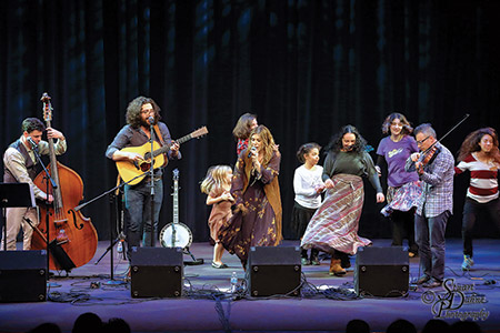 Nefesh Moutain, founded by husband and wife team Eric Lindberg (second from left) and Doni Zasloff (center) performed their brand of Jewish old-time and bluegrass music on the first night of Chanukah, Dec. 24, at the Gordon Center. The following night, the  couple's family and kid-friendly band, the Mama Doni Band, performed, also at the Owings Mills venue. (Stuart Dahne Photography)