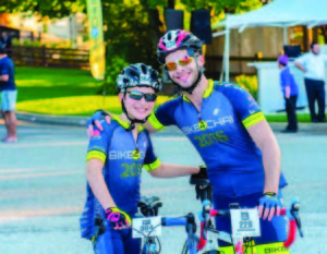 Moshe Moskowitz (left) poses for a photo with his brother, Naftali, during Bike4Chai. (Courtesy of Chai Lifeline)