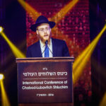 Rabbi Mendel Alperowitz, who is headed to South Dakota, addresses of the International Conference of Chabad-Lubavitch Emissaries. (Eliyahu Parypa/Chabad.org)