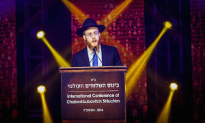 Rabbi Mendel Alperowitz, who is headed to South Dakota, addresses of the International Conference of Chabad-Lubavitch Emissaries. (Eliyahu Parypa/Chabad.org)