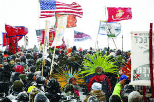 Veterans march with Standing Rock activists near Backwater Bridge just outside the Oceti Sakowin camp. LUCAS JACKSON/REUTERS/Newscom