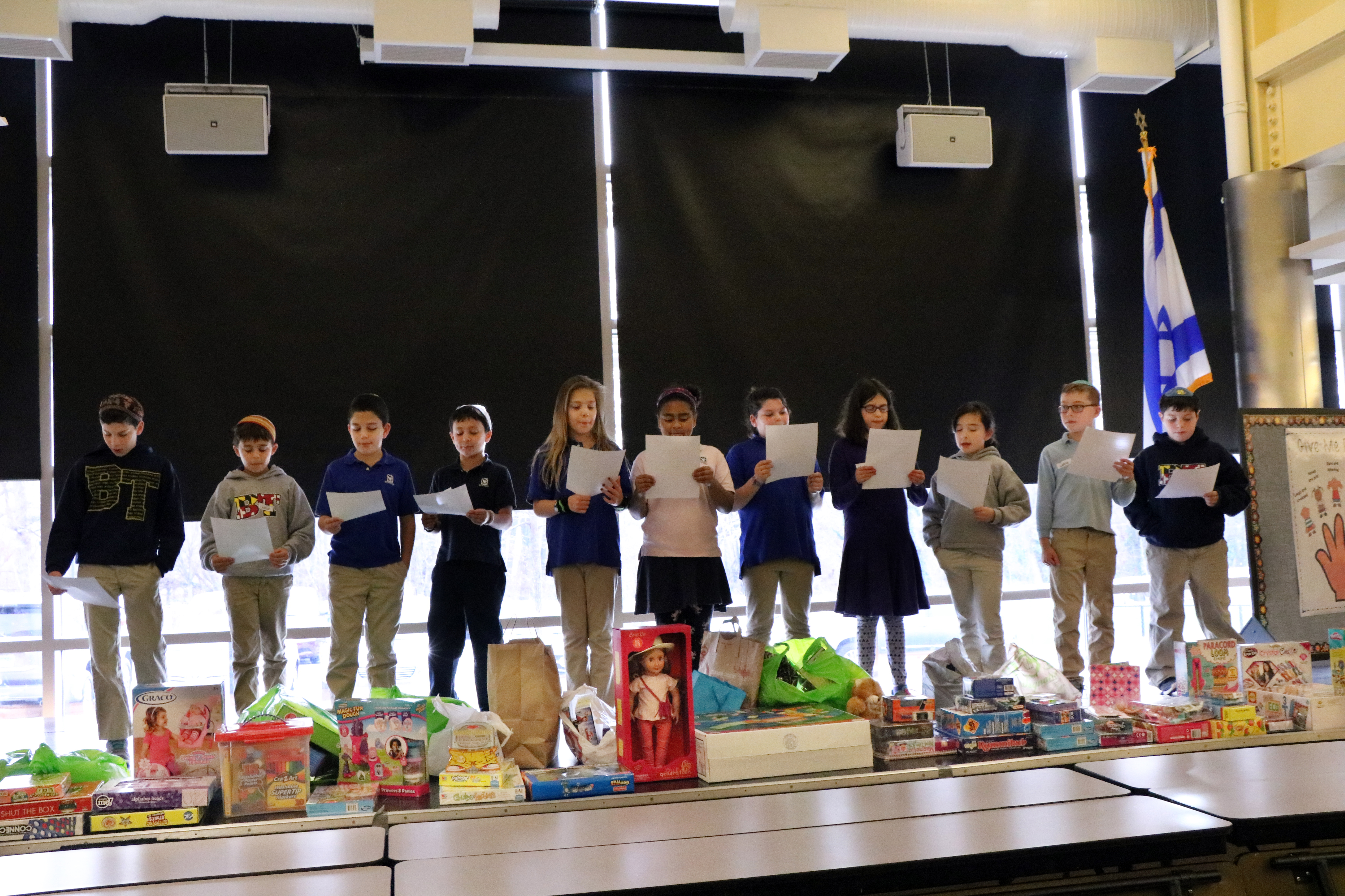 Fourth-graders at Beth Tfiloh Dahan Community School collected nearly 200 gifts for the Jewish Caring Network's Chanukah toy drive. The toys were distributed to children who face serious illnesses or who have ill family members. (Provided)