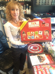 Cara Zaller shows off the completed Go Paleo! board game. (Photo by Daniel Nozick)