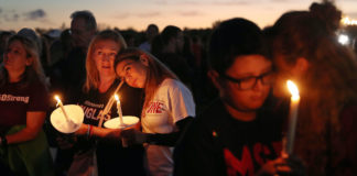 Teenagers at candlelight vigil in Florida following mass shooting in Parkland in 2019.
