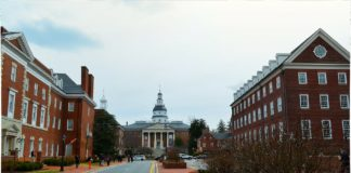 Capitol building in Annapolis, red brick with a white copula, visible in the distance.