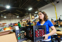 young woman organizes donated food