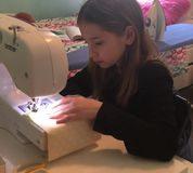 Maya Goldman sews a face mask. (Amie Perl)