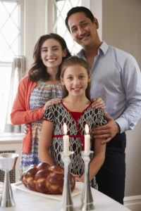 Jewish family with Shabbat candles and challah