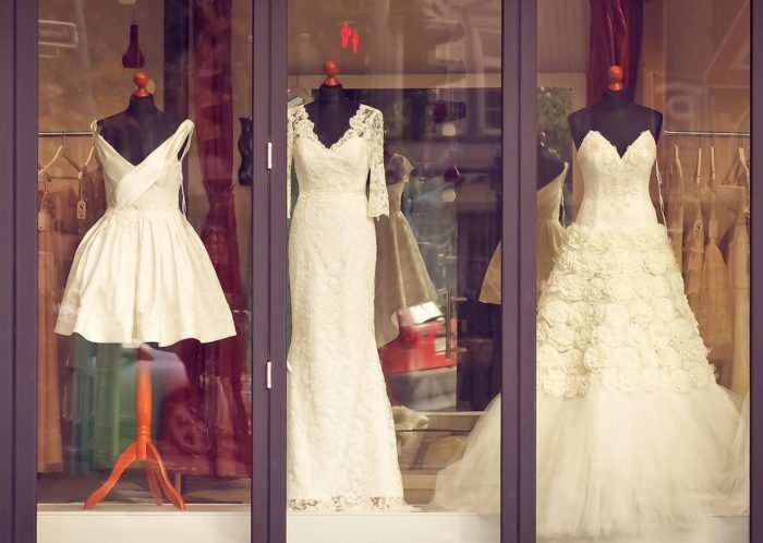 window display with 3 wedding dresses
