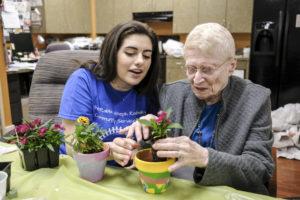 Beren Academy student Dina Kirshner and Medallion resident Marcene Goldman plant flowers