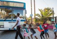 Refugees in Lesbos, Greece, return from a day of learning at the IsraAID-run School of Peace. (Courtesy of IsraAID)