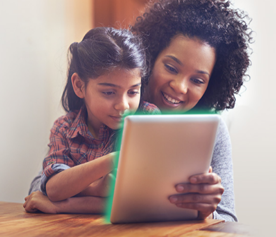 Child and adult using tablet computer