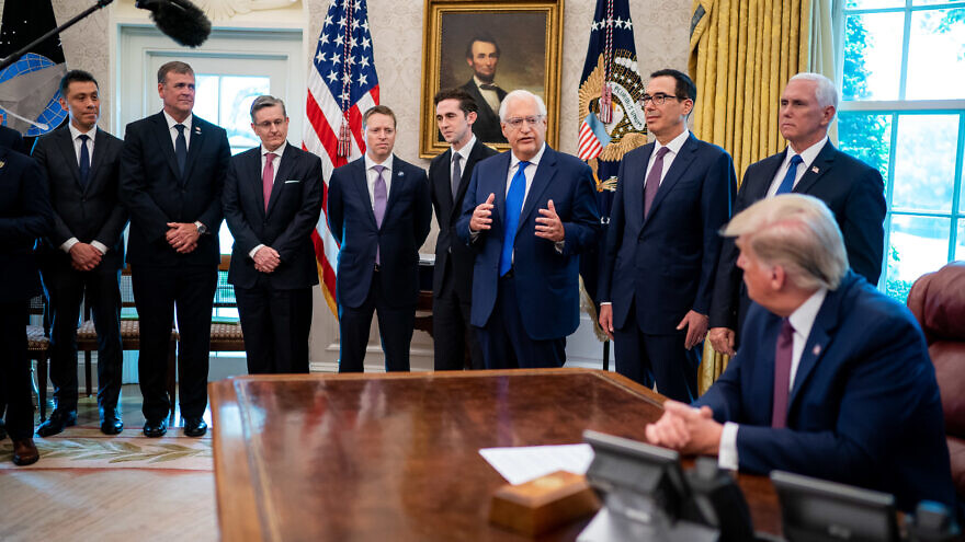 Caption: U.S. President Donald Trump listens as U.S. Ambassador to Israel David Friedman delivers remarks during the announcement of normalization of relations between Israel and the Kingdom of Bahrain on Sept. 11, in the Oval Office of the White House. (Tia Dufour/The White House)