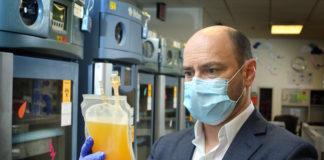 Dr. Shoham handles plasma for the tests (Johns Hopkins University)