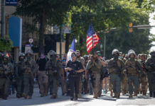 Armed gun rights protesters