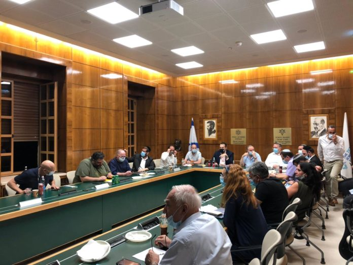 Representatives from various parties signing the agreement in Jerusalem on Oct. 22.