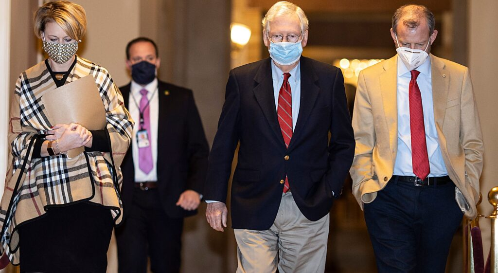 U.S. Senate Majority Leader Mitch McConnell (R-KY) walks to the senate floor on Capitol Hill in Washington, DC on December 20, 2020
